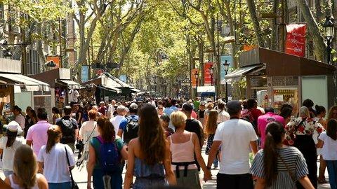 BARCELONA, SPAIN - AUGUST 04, 2016: Crowd Of People Walking On La Rambla Central Street In Barcelona City.