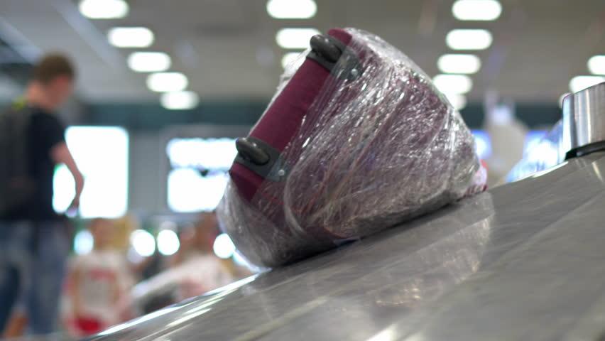 THAILAND, BANGKOK - CIRCA MAY 2016 - Baggage claim at Suvarnabhumi Airport, people collect luggage, Bangkok, Thailand.