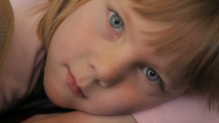 Close up of a little girl resting in a preschool class | Shutterstock HD Video #2545115