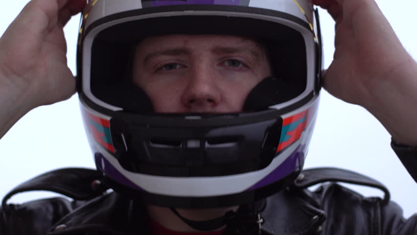 Racer wears a helmet before the start. Close-up