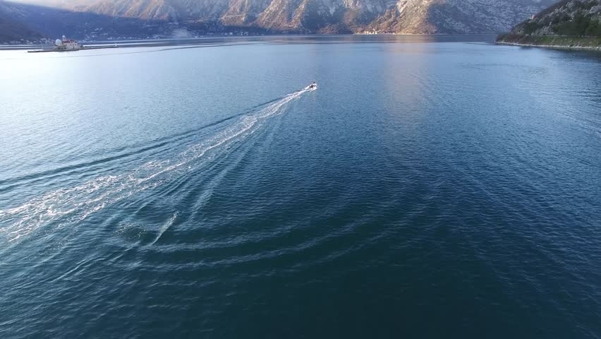 Speed Dinghy at high speed sailing on the sea. Kotor Bay in Montenegro. | Shutterstock HD Video #25476725