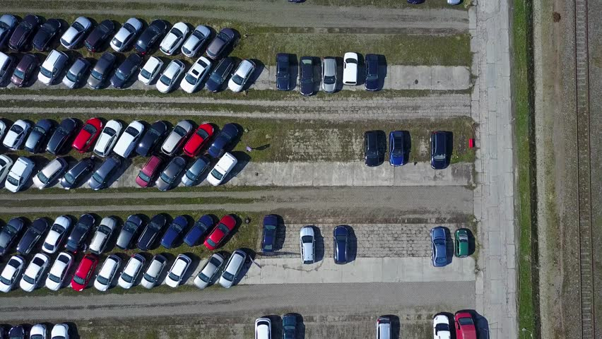 Aerial shot of new car parking, top view. 4K video
