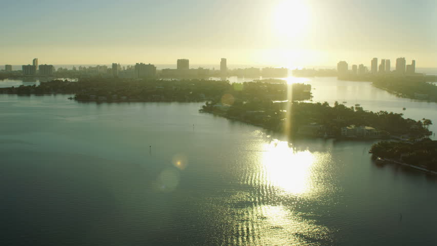 Aerial view at sunrise of Venetian Island Downtown Skyscrapers Condominiums city Waterfront Metropolitan Miami Florida USA RED WEAPON | Shutterstock HD Video #25501595