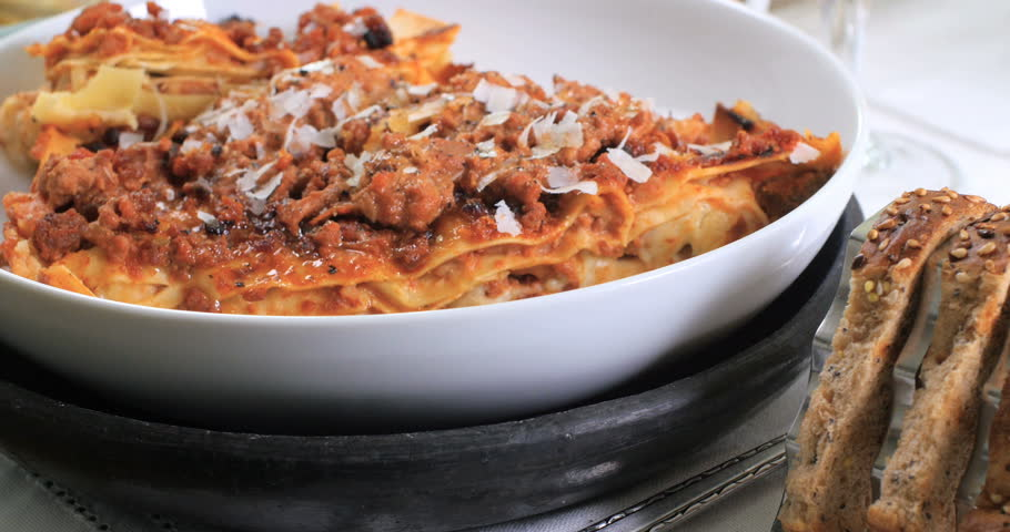 Dolly push in view of delicious steamy lasagne in bolognese sauce