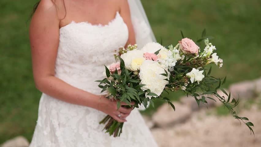 Wedding bridal bouquet of roses, lisianthus, lavender, Gypsophila, Verdure (Italian) in the hands of the bride. Wedding in Croatia, Dubrovnik. | Shutterstock HD Video #25542875