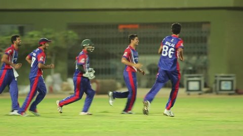 Players celebrating a win after a cricket match in a stadium, Karachi, Pakistan,