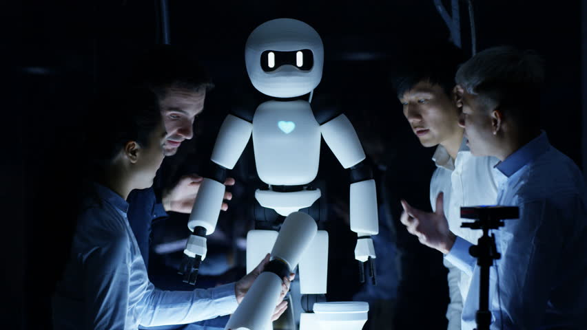 4K Electronics engineers collaborating on design of robot in dark lab   Shutterstock HD Video #25573865