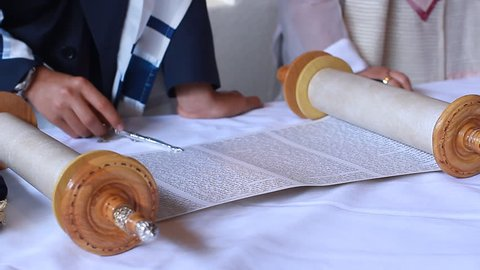 Hand of young boy reading the Jewish Torah at Bar Mitzvah Bar Mitzvah Torah