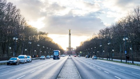 BERLIN, GERMANY – March 15, 2017: Berliner Victory Column hyperlapse tracking shot with sunset, evening Walk lapse on street to the Victory Column