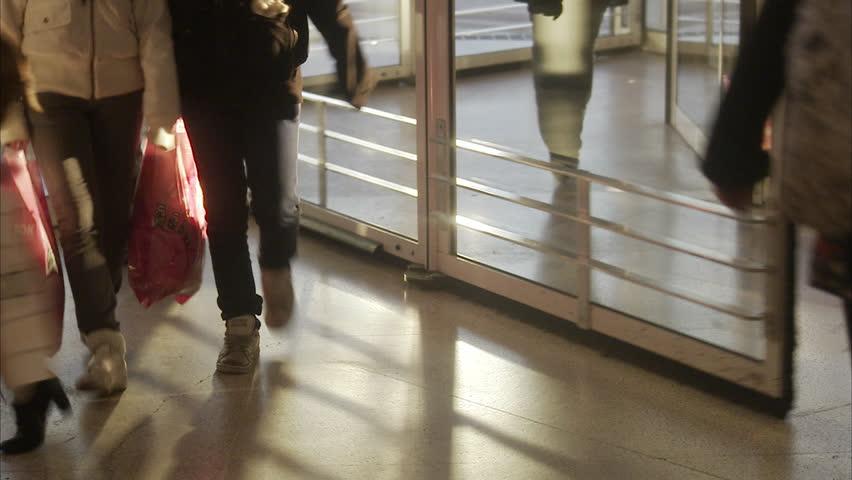 STOCKHOLM, SWEDEN - DECEMBER 2007: People walking in a revolving door, Sweden.