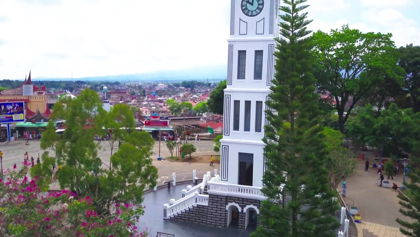 Aerial Drone Jam Gadang then Bukittinggi City with Mountain as background.