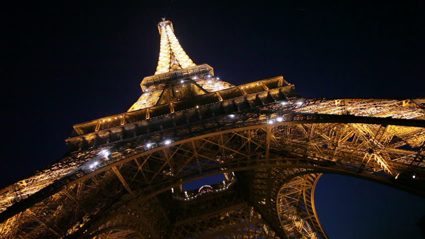 PARIS, FRANCE - CIRCA MAY 2011: View upwards from underneath the Eiffel Tower at night