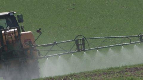 farmer spraying roundup