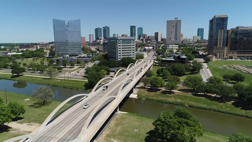 Fort Worth Skyline aerial w/ landmark 7th street Bridge and Trinity Trails Park- green grass blue sky