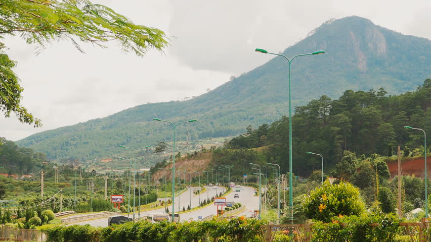 The highway with traffic on the way to the city of Dalat. Vietnam.