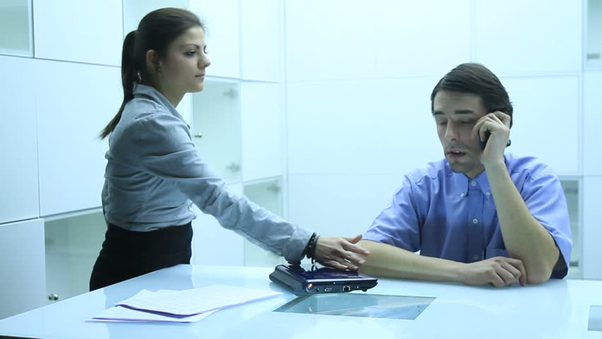 Young pretty busineswoman yelling at businessman in company | Shutterstock HD Video #2569415
