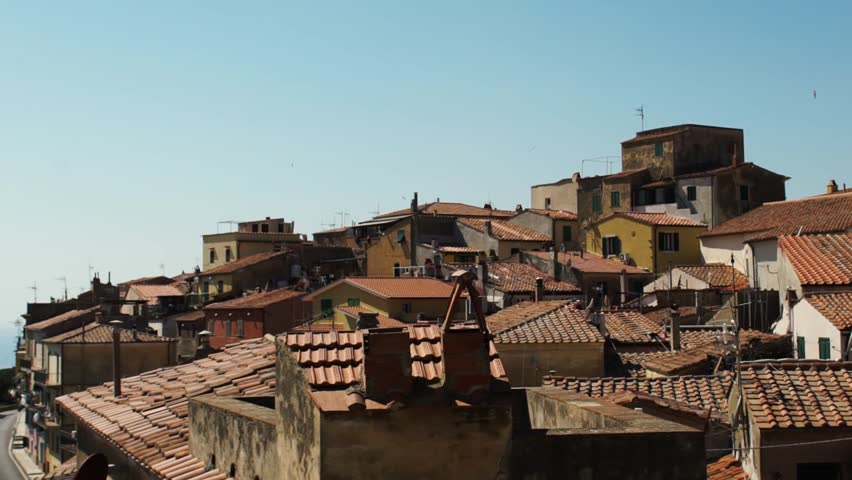 A nice little town with red tiled roofs by the sea in Elba island, Tuscany, Italy HD #25712795