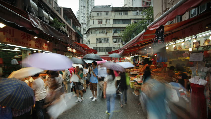 HONG KONG - CIRCA MAY 2011: Shoppers browse the traditional Chinese Stalls in Wanchai market