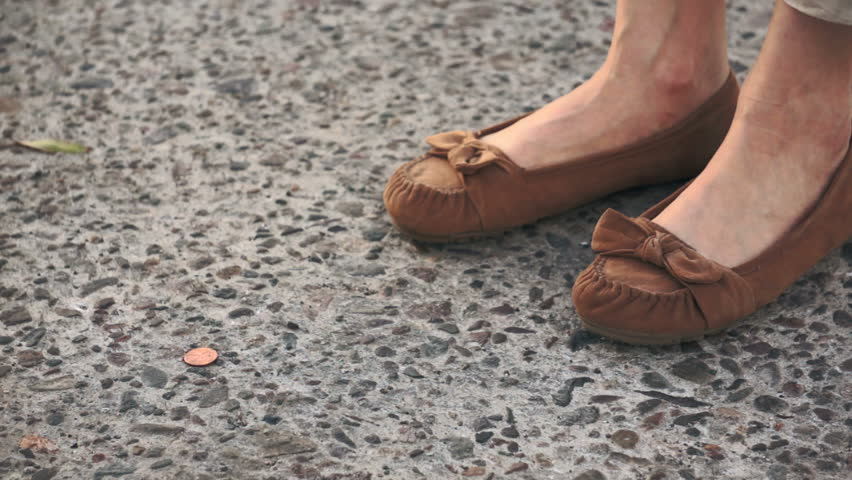 Woman Finding Lost Penny Coin on the Street
