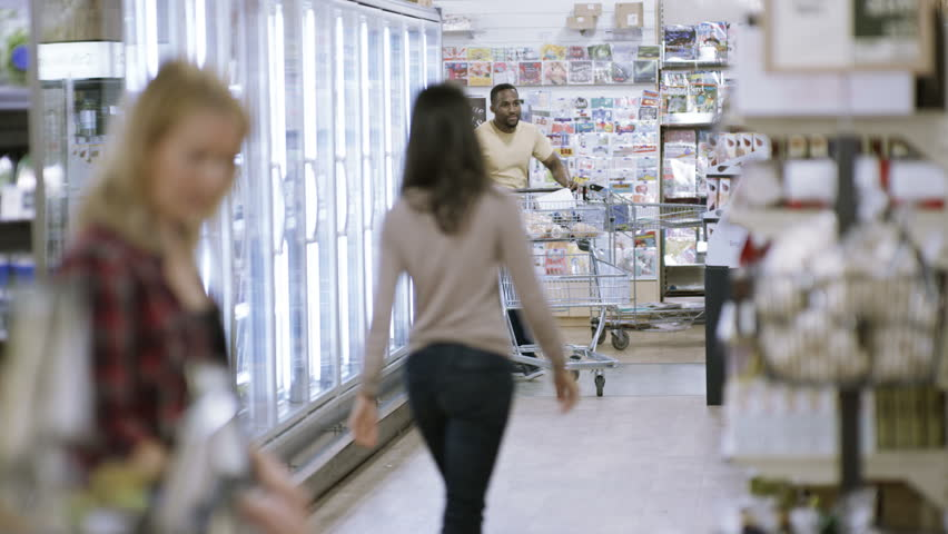 4K Happy carefree young man dancing as he does his shopping in supermarket | Shutterstock HD Video #25740185