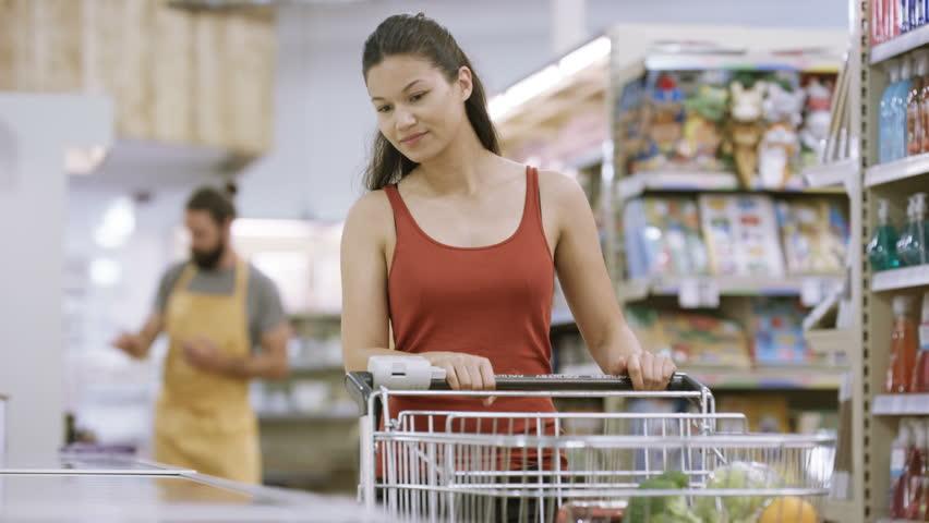 4K Customer shopping in frozen food aisle of supermarket. | Shutterstock HD Video #25742495