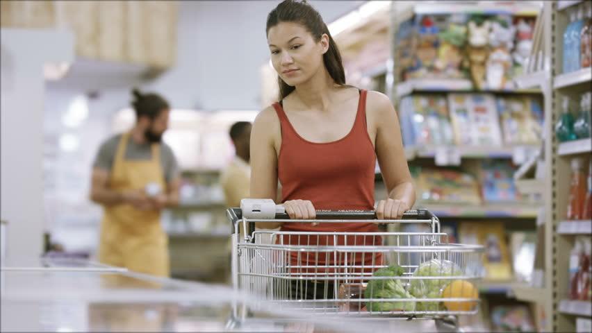 4K Customer shopping in frozen food aisle of supermarket | Shutterstock HD Video #25745885