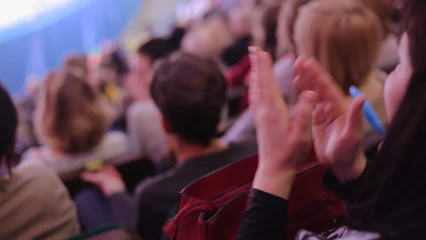 Close up of woman hands applauding at concert hall or theatre