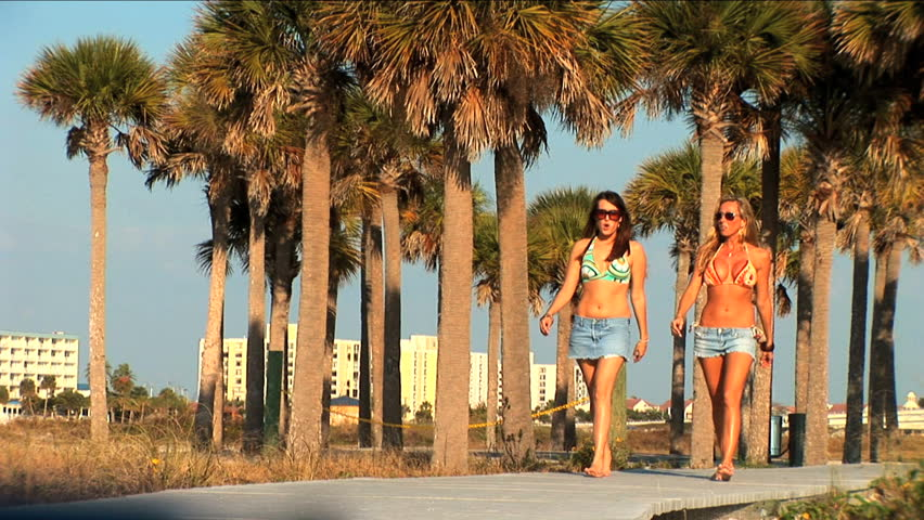 Beautiful young girls walking on the boardwalk