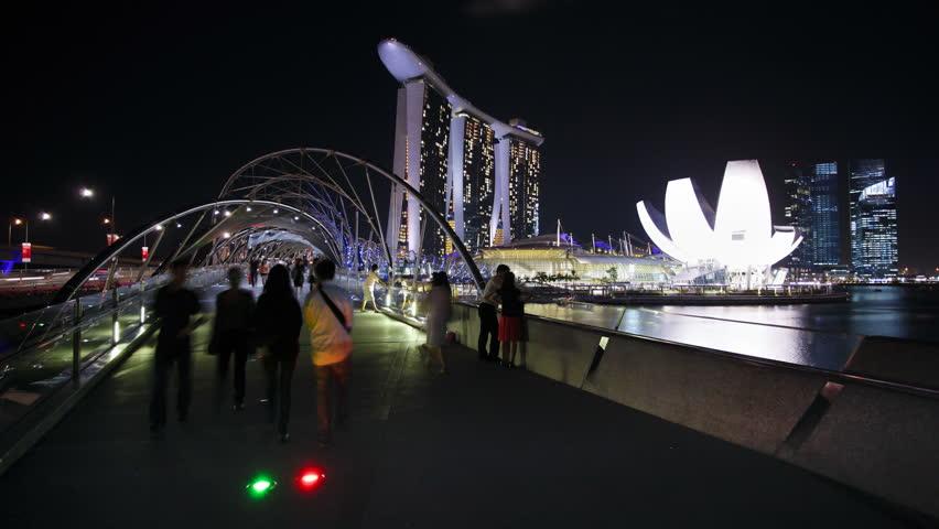 SINGAPORE - CIRCA MAY 2011: Night view of the illuminated Helix Bridge and Marina Bay Sands Singapore, Marina Bay #2579525