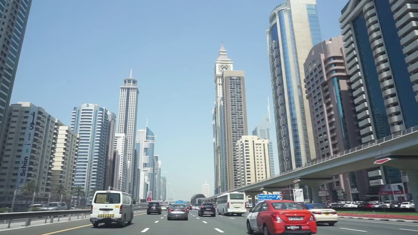 DUBAI, UAE - 01 APRIL 2017 : Driving on SHEIKH ZAYED ROAD from Abu Dhabi, A high number of tall towers on both side is very impressive.