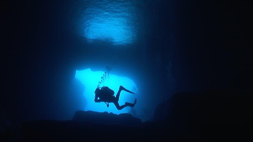 Cave dive underwater diving blue scuba divers exploring | Shutterstock HD Video #25848035
