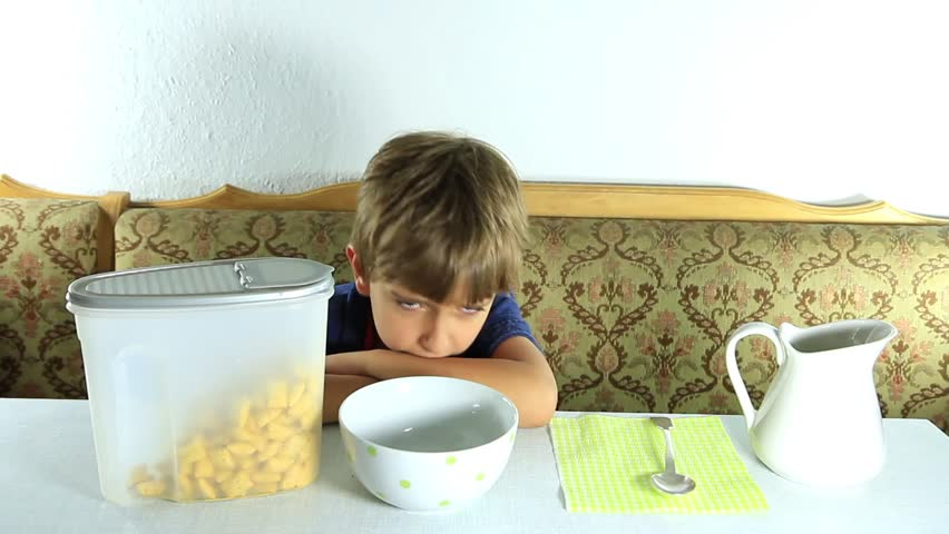 Boy eats granola with milk
