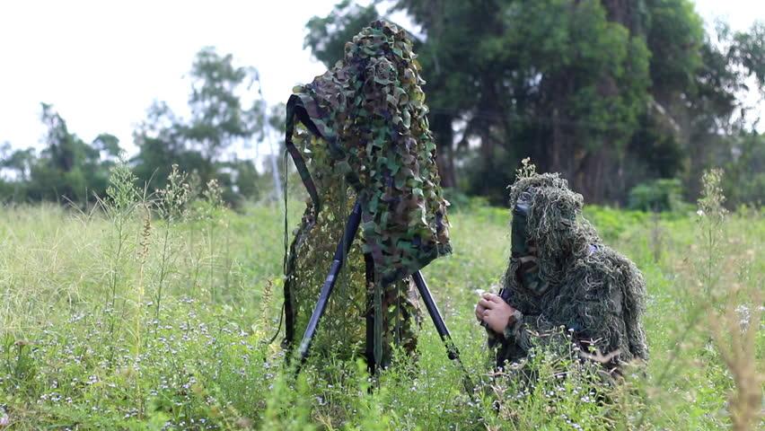 binoculars in the hand of ornithologist