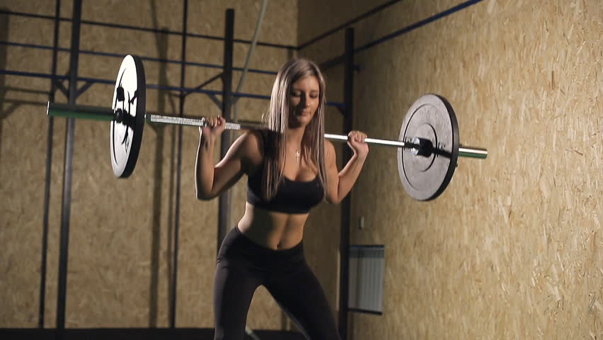 Muscular young fitness beautiful blonde girl lifting a weight cross fit in the gym. | Shutterstock HD Video #25903265