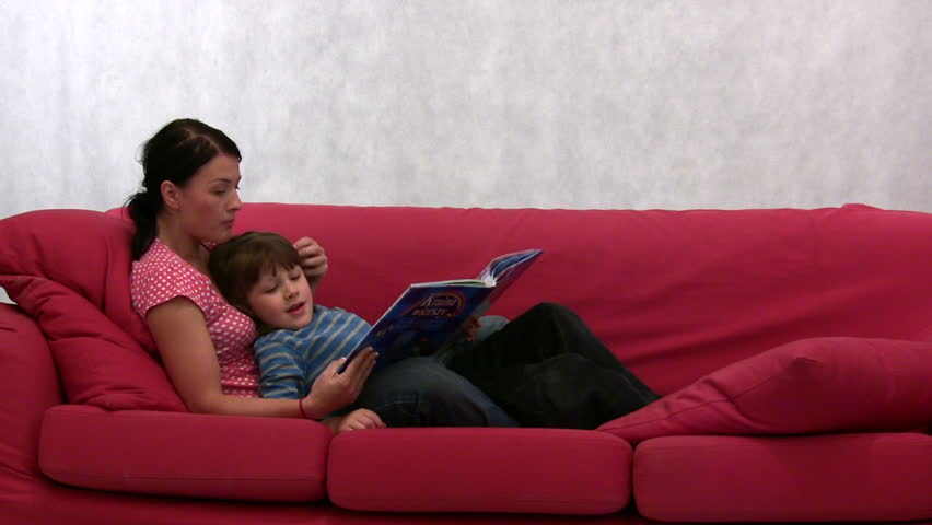 young mother and her son are reading a book