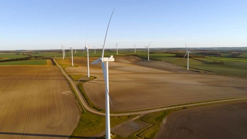 Wind energy farm slow smooth pan shot, aerial view