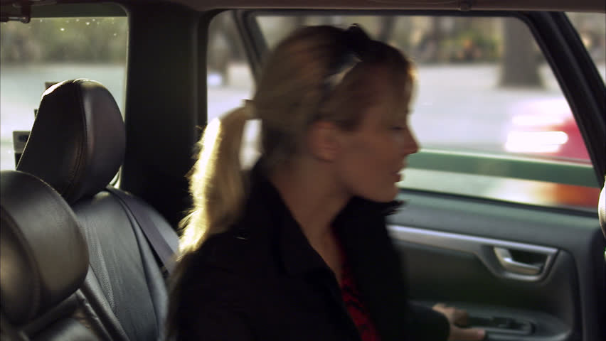 A woman in a cab