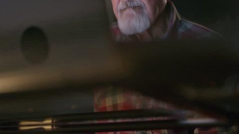 Close up low angle shot of older man using laptop / Cedar Hills, Utah, United States