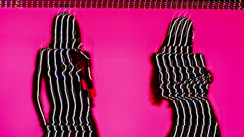silhouette of a beautiful sexy woman posing and slowly doing a striptease. this version has been passed through an analogue video effects unit to add glitch and distortion.