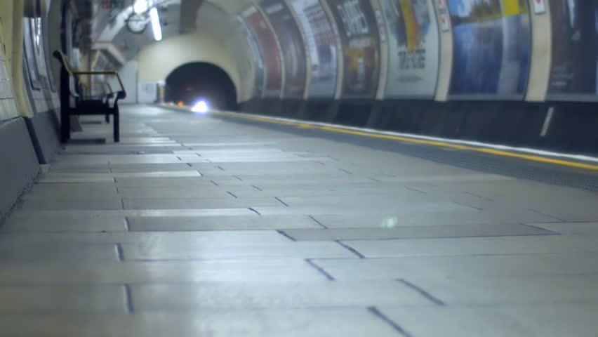An underground train arrives at a platform and passengers get off.