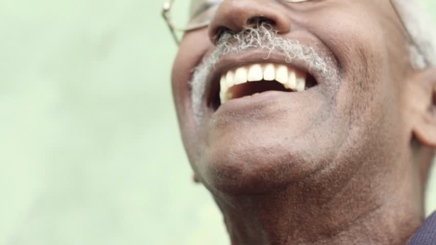 Seniors and feelings, elderly black man with glasses and mustache smiling. Slow motion #2598305