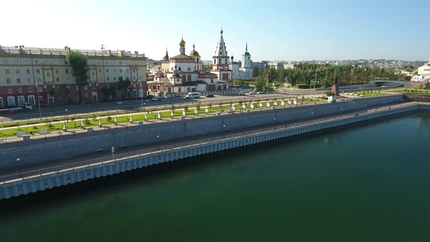 Cathedral of The Epiphany ancient temple Irkutsk Russia. Siberia. Old Christianity church ?oast embankment river Ob. Summer sunny day blue sky. Best aerial view. Drone forward