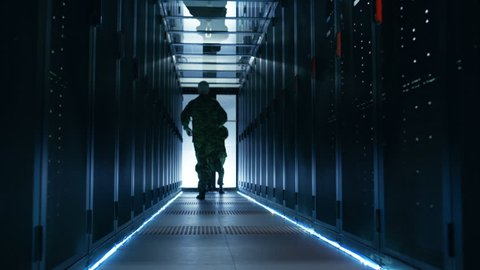 Security Alarm with Flasher Triggered in Data Center. Two Military Men Running in the Corridor full of Server Racks. Shot on RED EPIC-W 8K Helium Cinema Camera.