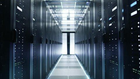 Camera Moves Through Big Working Data Center with Server Racks. Shot on RED EPIC-W 8K Helium Cinema Camera.