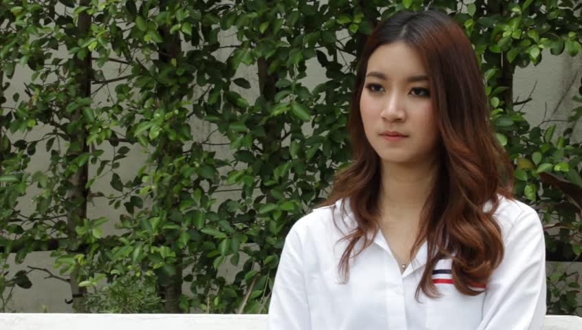 Portrait of thai adult beautiful girl white shirt using her smart phone   Shutterstock HD Video #26021615