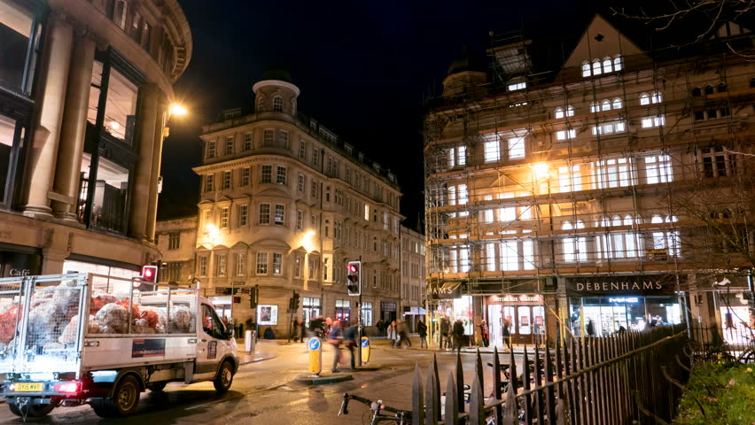 OXFORD, UK - CIRCA MARCH 2017: Busy nightlife timelapse, traffic and people | Shutterstock HD Video #26024465