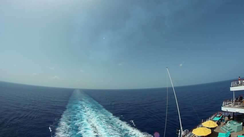 Looking off the back of a large cruise ship. | Shutterstock HD Video #2611445