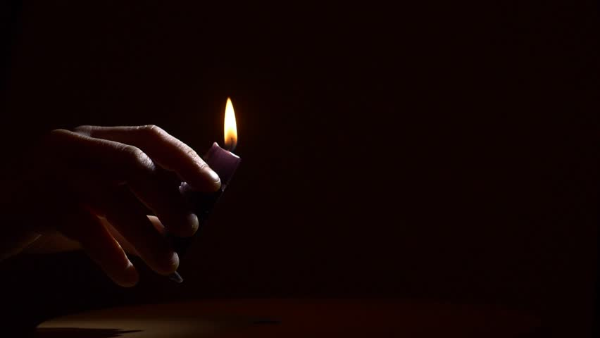 lighting for dark rooms. lighting black candle with matches hd stock video clip for dark rooms