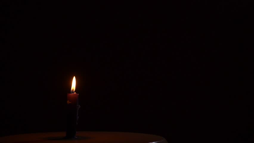 Blowing out of a black candle. Smoke on a black background slow motion   Shutterstock HD Video #26115965