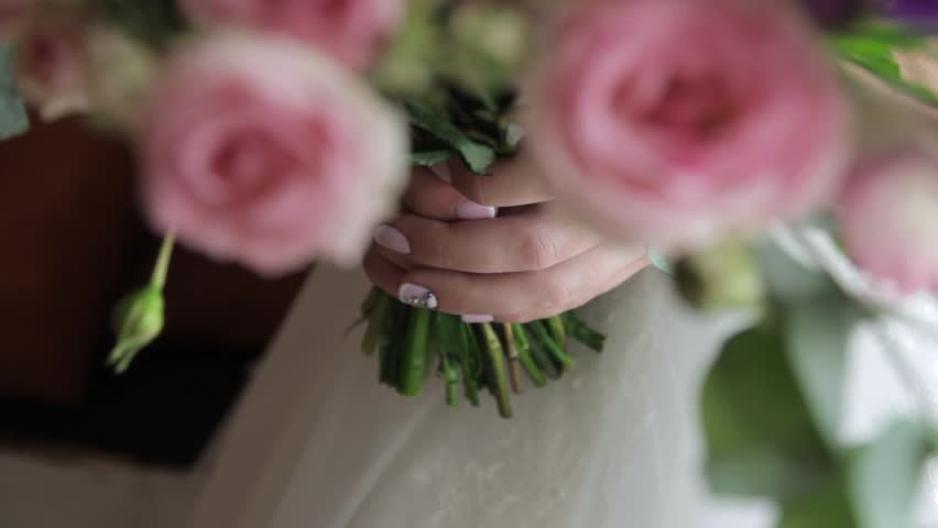 A beautiful bouquet in hand of bride. | Shutterstock HD Video #26152253
